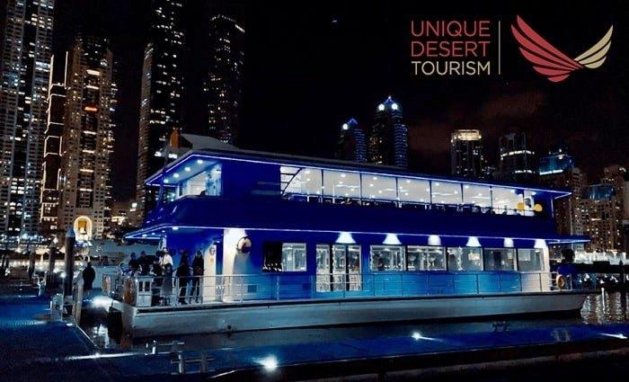 2-Hours Dubai Marina Luxury Catamaran Cruise with Five-Star Dinner Buffet plus Entertainment from Unique Desert Tourism.