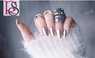 Eye catching chrome manicure and classic pedicure from Ravishing Ladies Salon for AED 99 only.