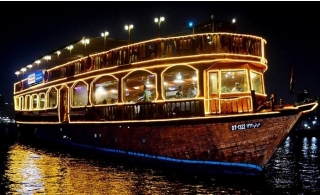 120-Minutes Cruise at Dubai Creek on Arabian Traditional Dhow with International Dinner Buffet.