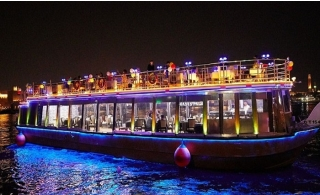 2-Hour Catamaran Glass Cruise at Dubai Creek with Dinner & Drinks from Oasis Palm Floating Restaurant.