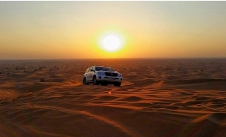 Private Sunset Desert Dune Safari (up to 6pax) with 10min Camel Ride and 20 min sand boarding with Hotel pick-up and drop off included
